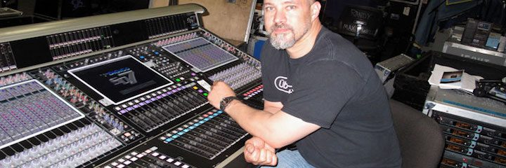 Clay Hutson at a soundboard